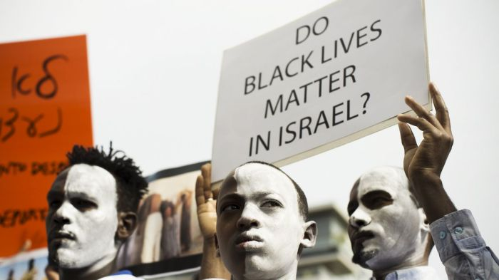 black israeli's protest after israel announces deportation
